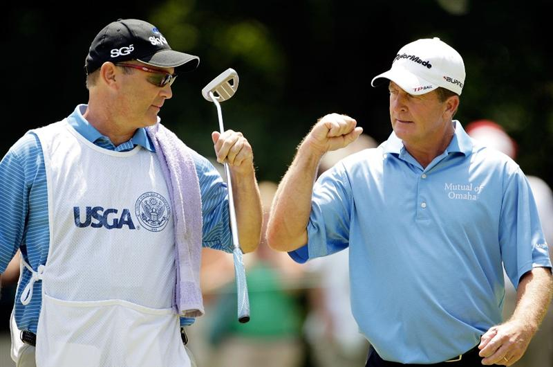 CARMEL, IN - AUGUST 02:  Fred Funk of the USA bumps fists with his caddie after making a putt for birdie on the 4th hole during the final round of the 2009 U.S. Senior Open on August 2, 2009 at Crooked Stick Golf Club in Carmel, Indiana.  (Photo by Jamie Squire/Getty Images)