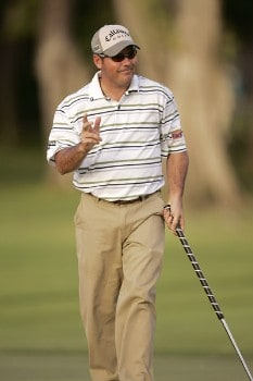Rich Beem waves to the crowd after making his putt on the 11th gree during the first round of the PGA TOUR's Sony Open, January 12, 2006 at the Waialae Country Club in Honolulu, Hawaii.Photo by M. Garcia/WireImage.com