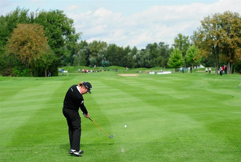 VIENNA, AUSTRIA - SEPTEMBER 16:  Miguel Angel Jimenez of Spain plays his approach shot on the seventh hole during the first round of the Austrian golf open presented by Botarin at the Diamond country club on September 16, 2010 in Atzenbrugg near Vienna, Austria.  (Photo by Stuart Franklin/Getty Images)