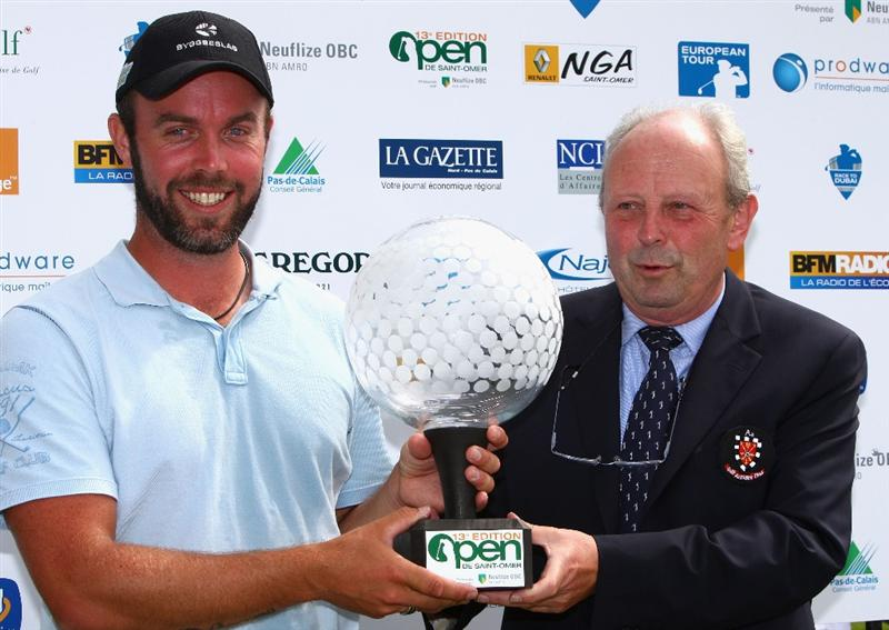 ST OMER, FRANCE - JUNE 21:  Christian Nilsson of Sweden is presented with his trophy after winning the Open de St Omer at the AA St Omer Golf Club on June 21, 2009 in St Omer, France.  (Photo by Ryan Pierse/Getty Images)