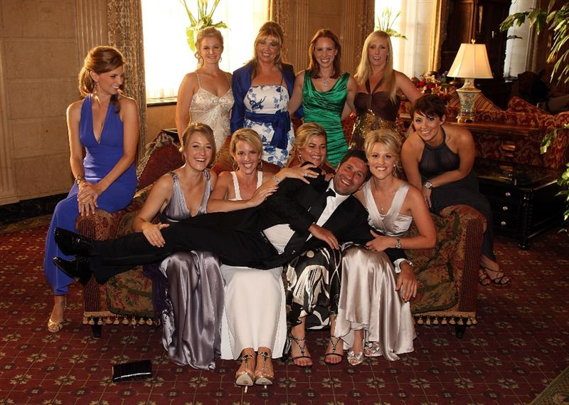 LOUISVILLE, KY - SEPTEMBER 17:  European Ryder Cup team assistant captain Jose Maria Olazabal of Spain poses with wives and partners of the European team at the Brown Hotel prior to the start of the 2008 Ryder Cup September 17, 2008 in Louisville, Kentucky.  (Photo by David Cannon/Getty Images)