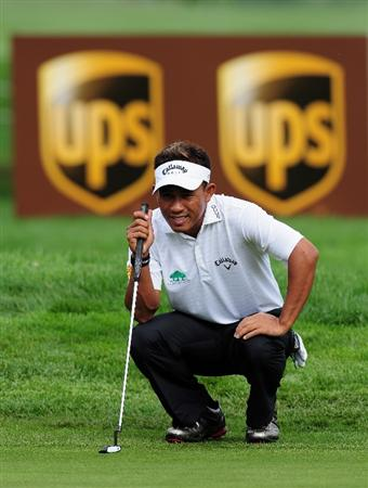 MUNICH, GERMANY - JUNE 26:  Thongchai Jaidee of Thailand lines up his putt on the 13th hole during the second round of The BMW International Open Golf at The Munich North Eichenried Golf Club on June 26, 2009, in Munich, Germany.  (Photo by Stuart Franklin/Getty Images)