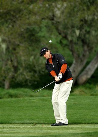 PEBBLE BEACH, CA - FEBRUARY 11: Bob Estes pitches on the second hole during the first round of the AT&T Pebble Beach National Pro-Am at Pebble Beach Golf Links on February 11, 2010 in Pebble Beach, California. (Photo by Stephen Dunn/Getty Images)