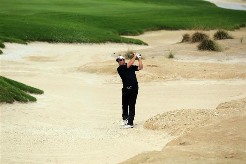 BAHRAIN, BAHRAIN - JANUARY 28:  David Dixon of England plays his second shot at the 18th hole during the second round of the 2011 Volvo Champions held at the Royal Golf Club on January 28, 2011 in Bahrain, Bahrain.  (Photo by David Cannon/Getty Images)