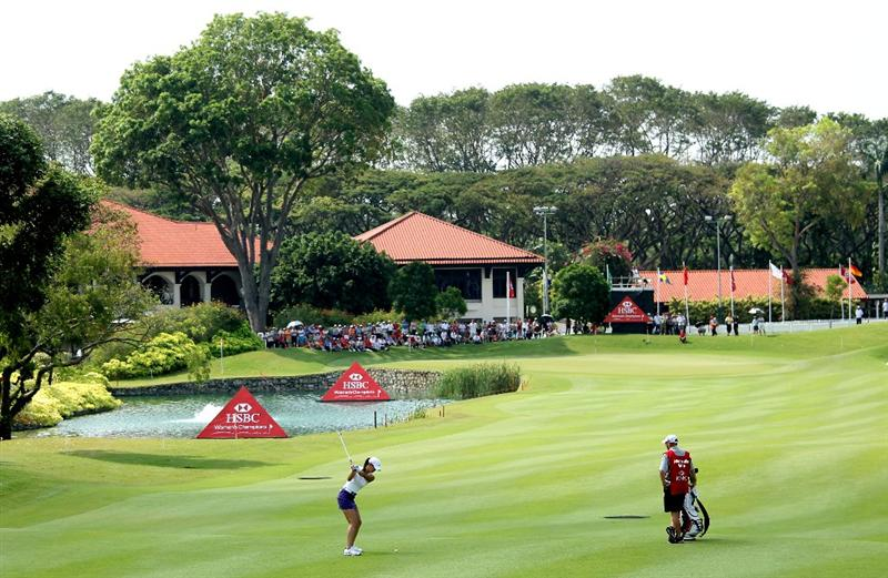 SINGAPORE - FEBRUARY 27:  Michelle Wie of the USA hits her second shot on the ninth hole during the third round of the HSBC Women's Champions at the Tanah Merah Country Club on February 27, 2010 in Singapore.  (Photo by Andrew Redington/Getty Images)