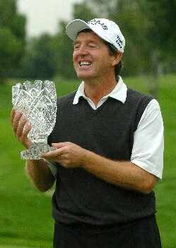 Des Smyth holds the winner's trophy after finishing one stroke ahead of Mark McNulty in the final round of the Champions' Tour 2005 SBC Classic at  the Valencia Country Club in Valencia, California March 13, 2005.