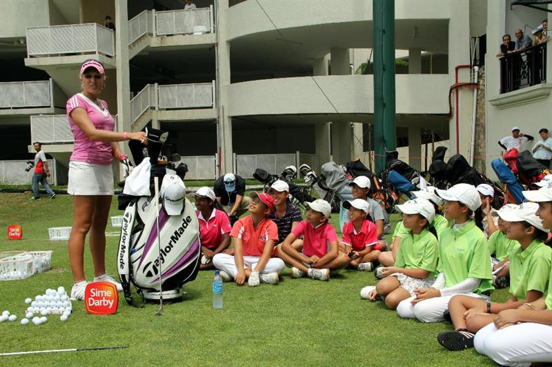KUALA LUMPUR, MALAYSIA - OCTOBER 20:  Natalie Gulbis of USA speaks to the kids during the Sime Darby LPGA Junior Clinics on October 20, 2010 held at the KLGCC Golf Course in Kuala Lumpur, Malaysia (Photo by Stanley Chou/Getty Images)