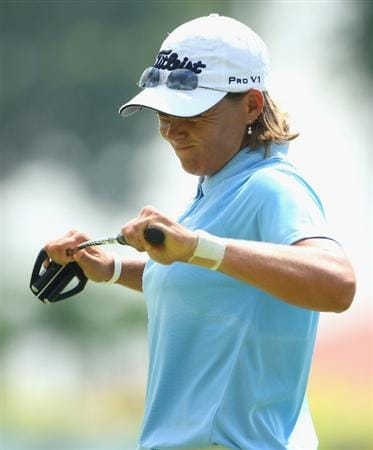 SINGAPORE - MARCH 08:  Katherine Hull of Australia bends her putter after a missed putt on the second hole during the final round of the HSBC Women's Champions at Tanah Merah Country Club on March 8, 2009 in Singapore.  (Photo by Andrew Redington/Getty Images)