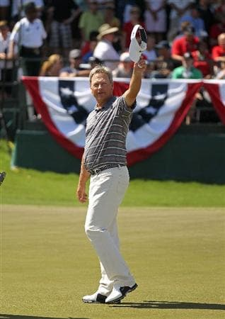LUTZ, FL - APRIL 17:  John Cook reacts after winning the Outback Steakhouse Pro-Am at the TPC of Tampa on April 17, 2011 in Lutz, Florida.  (Photo by Mike Ehrmann/Getty Images)