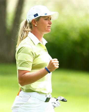 SUGAR GROVE, IL - AUGUST 22:  Suzann Pettersen of the European Team celebrates her second shot to the 15th green during the saturday morning fourball matches at the 2009 Solheim Cup at Rich Harvest Farms on August 22, 2009 in Sugar Grove, Illinois.  (Photo by Scott Halleran/Getty Images)