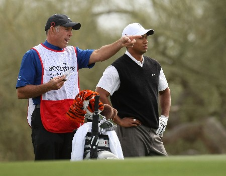 MARANA, AZ - FEBRUARY 20:   Tiger Woods and caddie Steve Williams discuss Woods' second shot on the second hole during the first round matches of the WGC-Accenture Match Play Championship at The Gallery at Dove Mountain on February 20, 2008 in Marana, Arizona. (Photo by Stephen Dunn/Getty Images)