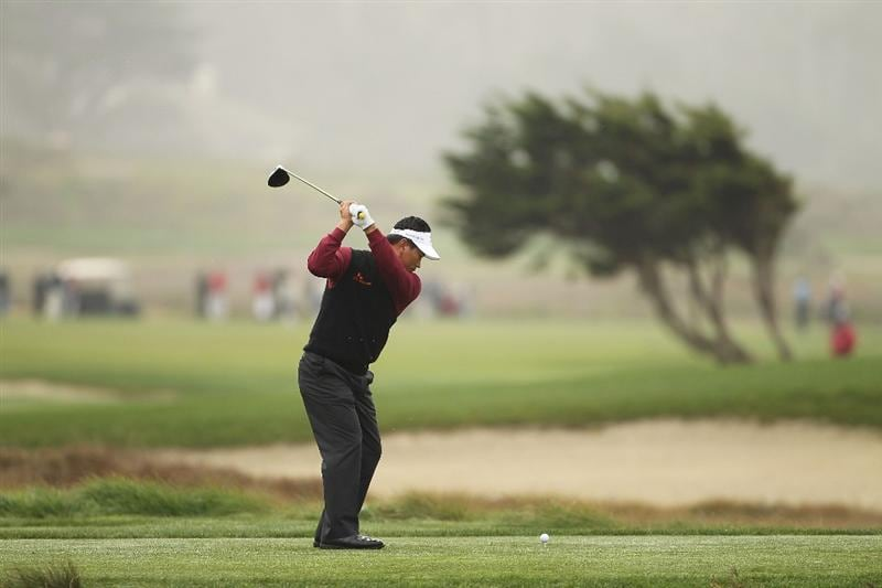 PEBBLE BEACH, CA - FEBRUARY 12:  K.J. Choi of South Korea tees off on the 12th hole during round two of the AT&T Pebble Beach National Pro-Am at the Monterey Peninsula Country Club Shore Course on February 12, 2010 in Pebble Beach, California.  (Photo by Ezra Shaw/Getty Images)