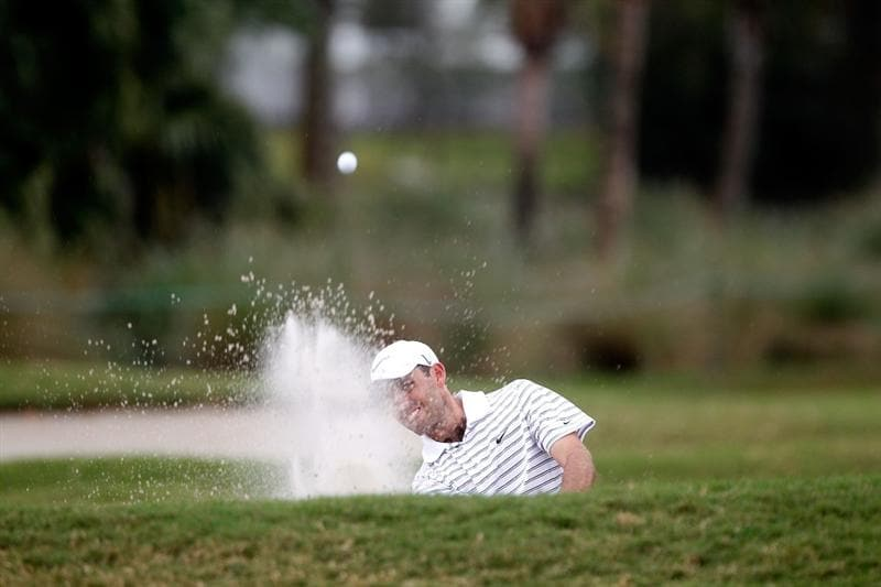 DORAL, FL - MARCH 12:  Charl Schwartzel of South Africa thits out of the bunker on the 13th tee box during round two of the 2010 WGC-CA Championship at the TPC Blue Monster at Doral on March 12, 2010 in Doral, Florida.  (Photo by Scott Halleran/Getty Images)
