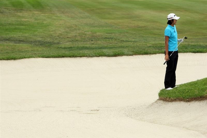 LA JOLLA, CA - SEPTEMBER 18: Song-Hee Kim of South Korea stands on the lip of the bunker on the 1st hole during the second round of the LPGA Samsung World Championship on September 18, 2009 at Torrey Pines Golf Course in La Jolla, California.  (Photo By Donald Miralle/Getty Images)