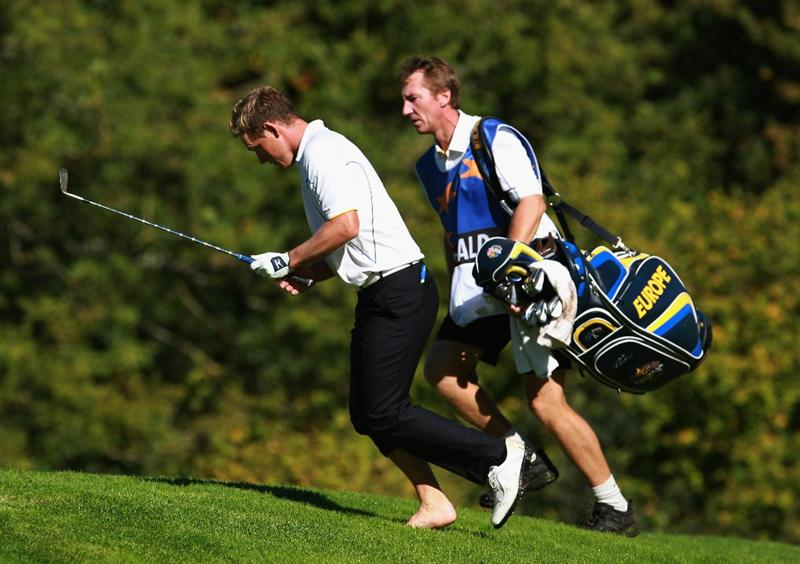 NEWPORT, WALES - OCTOBER 04:  Luke Donald of Europe follows his ball after hitting from the rough on the 15th hole in the singles matches during the 2010 Ryder Cup at the Celtic Manor Resort on October 4, 2010 in Newport, Wales.  (Photo by Andrew Redington/Getty Images)