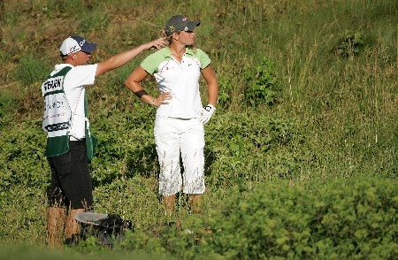 HAVRE DE GRACE, MD - JUNE 9:  Suzann Pettersen of Norway and her caddie discuss where to hit the ball out of the rough on the par 5 15th hole during the third round of the McDonalds LPGA Championship at Bulle Rock golf course June 9, 2007 in Havre de Grace, Maryland.  (Photo by Andy Lyons/Getty Images)