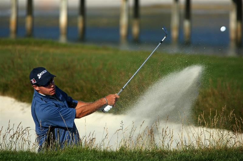PEBBLE BEACH, CA - JUNE 17:  Brian Davis of England hits a bunker shot on the 17th hole during the first round of the 110th U.S. Open at Pebble Beach Golf Links on June 17, 2010 in Pebble Beach, California.  (Photo by Donald Miralle/Getty Images)