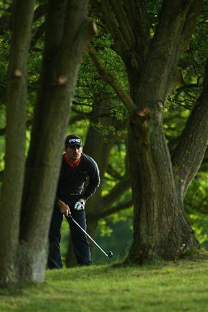 WENTWORTH, ENGLAND - MAY 21:  Alejandro Canizares of Spain plays out of the trees on the first hole during the First Round of the BMW PGA Championship at Wentworth on May 21, 2009 in Virginia Water, England.  (Photo by Richard Heathcote/Getty Images)