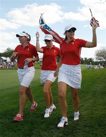 SUGAR GROVE, IL - AUGUST 23:  Brittany Lang, Paula Creamer and Nicole Castrale of the U.S. Team run up the 17th hole during the Sunday singles matches at the 2009 Solheim Cup at Rich Harvest Farms on August 23, 2009 in Sugar Grove, Illinois.  (Photo by Chris Graythen/Getty Images)