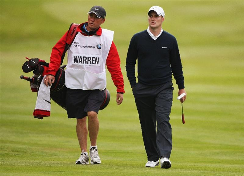 WENTWORTH, ENGLAND - MAY 22:  Marc Warren of Scotland walks towards the 18th green during the Second Round of the BMW PGA Championship at Wentworth on May 22, 2009 in Virginia Water, England.  (Photo by Warren Little/Getty Images)