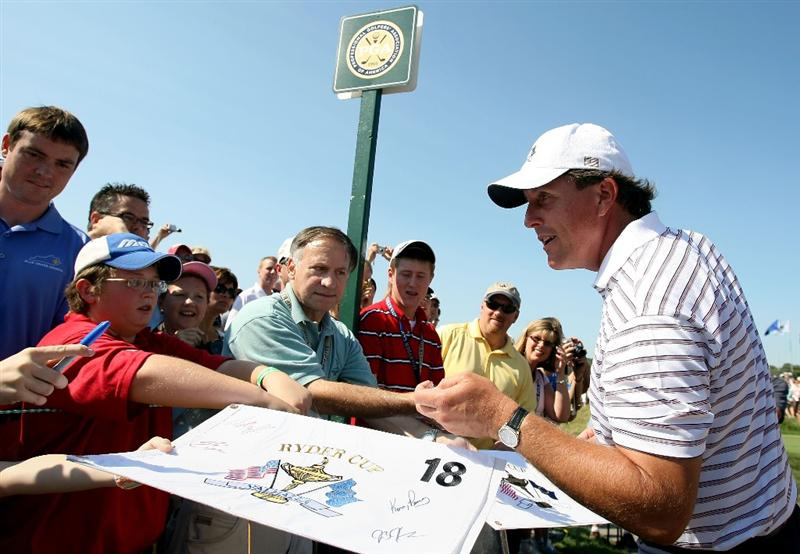 LOUISVILLE, KY - SEPTEMBER 18:  Phil Mickelson of the USA team signs autographs during his practice round prior to the 2008 Ryder Cup at Valhalla Golf Club on September 18, 2008 in Louisville, Kentucky.  (Photo by Harry How/Getty Images)