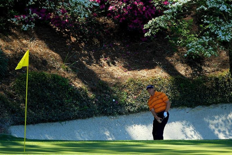 AUGUSTA, GA - APRIL 07:  Retief Goosen of South Africa hits his second shot from a bunker on the 12th hole during the first round of the 2011 Masters Tournament at Augusta National Golf Club on April 7, 2011 in Augusta, Georgia.  (Photo by David Cannon/Getty Images)