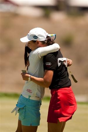 MORELIA, MEXICO - APRIL 29: Ai Miyazato of Japan (L) hugs Lorena Ochoa of Mexico after Miyazato set the course record with a 10-under par 63 in the first round of the Tres Marias Championship at the Tres Marias Country Club on April 29, 2010 in Morelia, Mexico. (Photo by Darren Carroll/Getty Images)