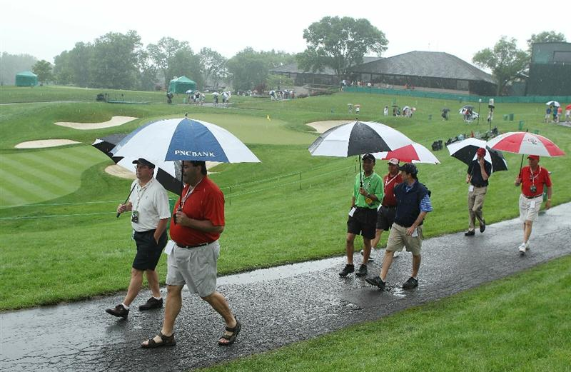 DUBLIN, OH - JUNE 03:  Fans walk past the 18th green after play was suspended due to dangerous weather during the first round of the Memorial Tournament presented by Morgan Stanley at Muirfield Village Golf Club on June 3, 2010 in Dublin, Ohio.  (Photo by Scott Halleran/Getty Images)