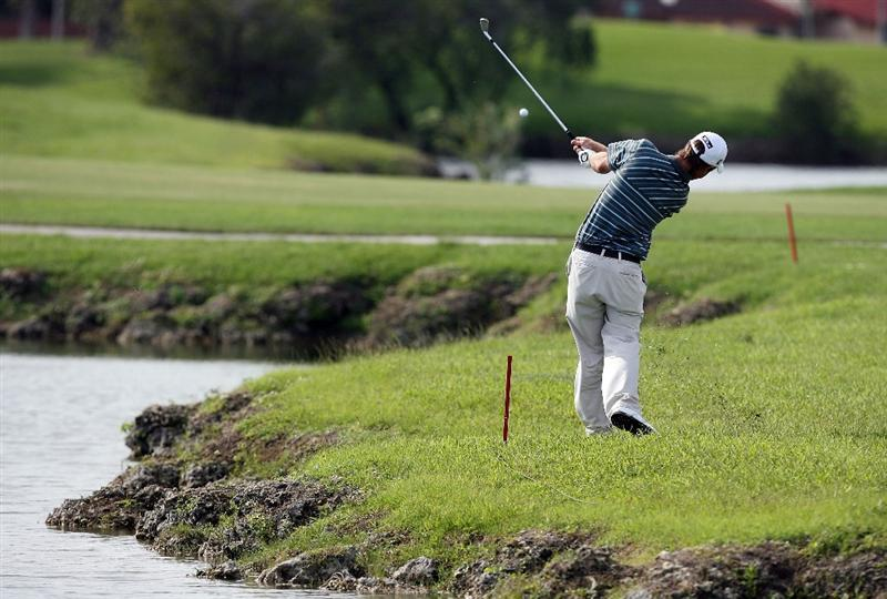 MIAMI - OCTOBER 18:  Andrew Buckle of Australia hits out of the rough after having to take a drop out of the hazard on the 16th hole during the final round of the 2009 Nationwide Tour Miccosukee Championship at the Miccosukee Golf & Country Club on October 18, 2009 in Miami, Florida.  (Photo by Doug Benc/Getty Images)