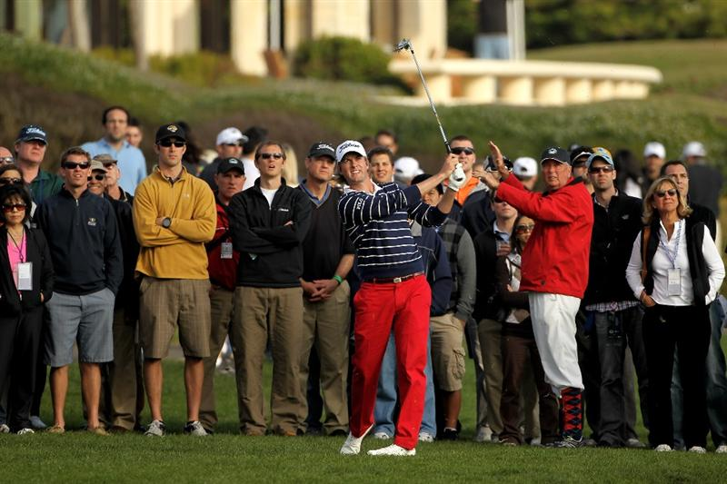 PEBBLE BEACH, CA - FEBRUARY 13:  Webb Simpson hits his approach shot on the 18th hole during round three of the AT&T Pebble Beach National Pro-Am at Pebble Beach Golf Links on February 13, 2010 in Pebble Beach, California.  (Photo by Ezra Shaw/Getty Images)