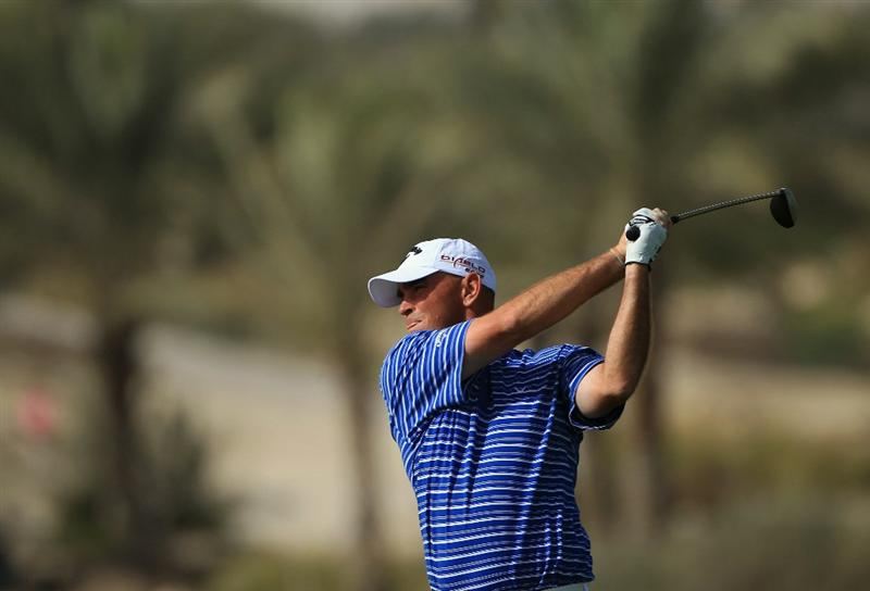 DOHA, QATAR - FEBRUARY 05:  Thomas Bjorn of Denmark plays his second shot on the ninth hole during the third round of the Commercialbank Qatar Masters held at Doha Golf Club on February 5, 2011 in Doha, Qatar.  (Photo by Andrew Redington/Getty Images)
