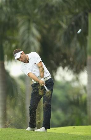 SINGAPORE - NOVEMBER 12:  Nick Dougherty of England in action during the First Round of the Barclays Singapore Open at Sentosa Golf Club on November 12, 2010 in Singapore, Singapore.  (Photo by Ian Walton/Getty Images)