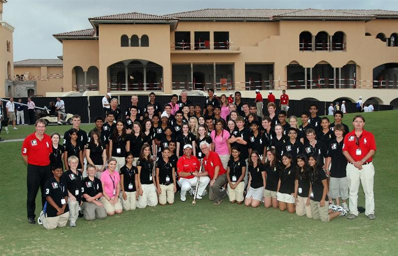 DUBAI, UNITED ARAB EMIRATES - NOVEMBER 22:  Lee Westwood of England with the Dubai World Championship Trophy and the children of Dubai College who worked as scoreboard operators after his victory in the final round of the Dubai World Championship, on the Earth Course, Jumeirah Golf Estates on November 22, 2009 in Dubai, United Arab Emirates  (Photo by David Cannon/Getty Images)
