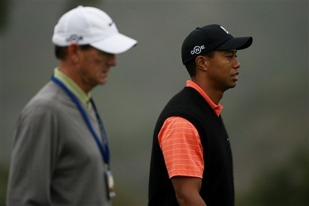 SAN DIEGO - JUNE 10:  Swing coach Hank Haney (L) and Tiger Woods walk up a fairway green during the second day of previews to the 108th U.S. Open at the Torrey Pines Golf Course (South Course) on June 10, 2008 in San Diego, California.  (Photo by Travis Lindquist/Getty Images)