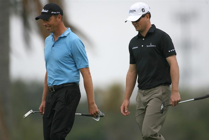 DORAL, FL - MARCH 12:  Soren Hansen of Denmark and Zach Johnson walk to the fifth tee box during round two of the 2010 WGC-CA Championship at the TPC Blue Monster at Doral on March 12, 2010 in Doral, Florida.  (Photo by Marc Serota/Getty Images)