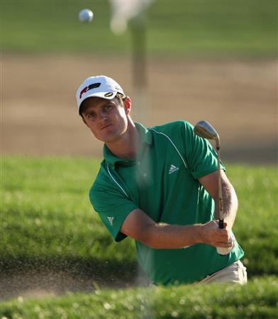 DUBAI, UNITED ARAB EMIRATES - JANUARY 31:  Justin Rose of England plays from a bunker on the sixth hole during the third round of the Dubai Desert Classic on the Majilis course at Emirates Golf Club on January 31, 2009 in Dubai, United Arab Emirates.  (Photo by Andrew Redington/Getty Images)
