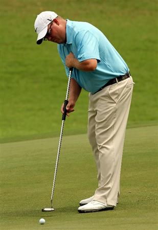 KUALA LUMPUR, MALAYSIA - OCTOBER 29: Carl Pettersson of Sweden putts on the 1st hole during day two of the CIMB Asia Pacific Classic at The MINES Resort & Golf Club on October 29, 2010 in Kuala Lumpur, Malaysia.  (Photo by Stanley Chou/Getty Images)