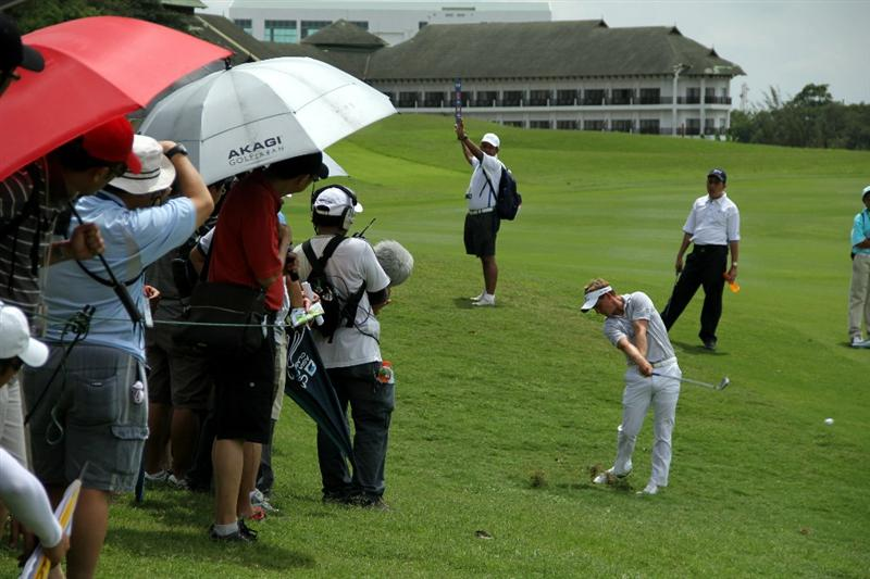 KUALA LUMPUR, MALAYSIA - OCTOBER 31: Luke Donald of England hits his 2nd shot on the 10th hole during day four of the CIMB Asia Pacific Classic at The MINES Resort & Golf Club on October 31, 2010 in Kuala Lumpur, Malaysia. (Photo by Stanley Chou/Getty Images)