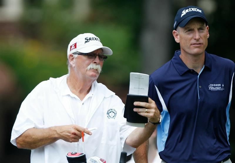 DUBLIN, OH - JUNE 04:  Jim Furyk watches his tee chats with his caddie Mike Cowan on the eighth hole during the second round of the Memorial Tournament presented by Morgan Stanley at Muirfield Village Golf Club on June 4, 2010 in Dublin, Ohio.  (Photo by Scott Halleran/Getty Images)