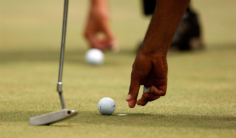 CHARLOTTE, NC - MAY 02:  Tiger Woods and Jim Furyk mark their golf balls on the fourth green during the third round of the Quail Hollow Championship at the Quail Hollow Club on May 2, 2009 in Charlotte, North Carolina.  (Photo by Streeter Lecka/Getty Images)