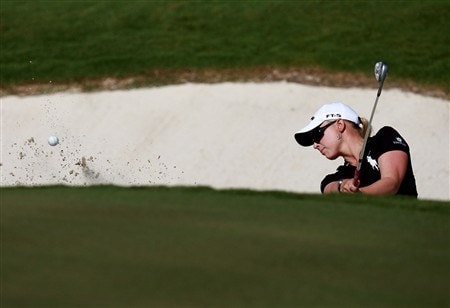 AVENTURA, FL - APRIL 24:  Morgan Pressel hits out of the bunker on the first hole in the first round of the Stanford International Pro-Am at Fairmont Turnberry Isle Resort & Club April 24, 2008 in Aventura, Florida.  (Photo by Doug Benc/Getty Images)