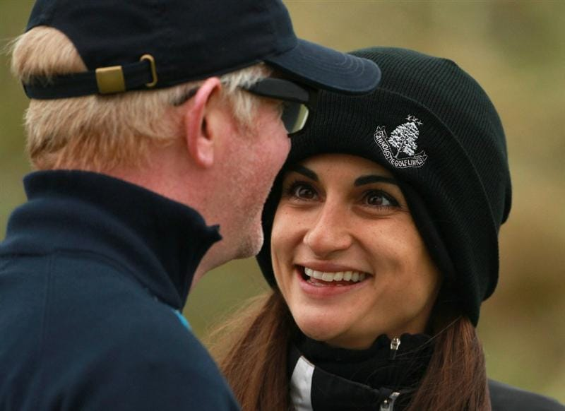 CARNOUSTIE, SCOTLAND - OCTOBER 09:  Broadcaster Chris Evans with his wife Natasha Shishmanian on the second hole during the third round of The Alfred Dunhill Links Championship at the Carnoustie Golf Links on October 9, 2010 in Carnoustie, Scotland.  (Photo by Andrew Redington/Getty Images)