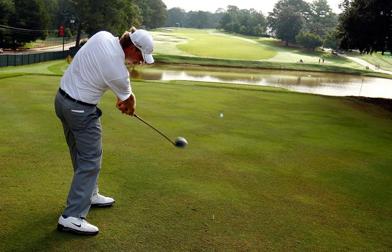 ATLANTA - SEPTEMBER 23:  Lucas Glover hits a shot during a practice round prior to the start of THE TOUR Championship at East Lake Golf Club on September 23, 2009 in Atlanta, Georgia.  (Photo by Scott Halleran/Getty Images)