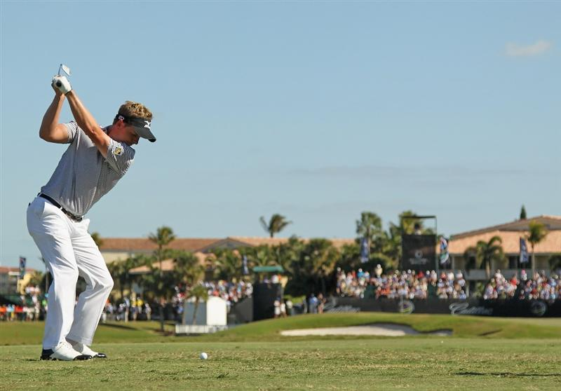 DORAL, FL - MARCH 13:  Luke Donald of England hits his tee shot on the ninth hole during the final round of the 2011 WGC- Cadillac Championship at the TPC Blue Monster at the Doral Golf Resort and Spa on March 13, 2011 in Doral, Florida.  (Photo by Mike Ehrmann/Getty Images)