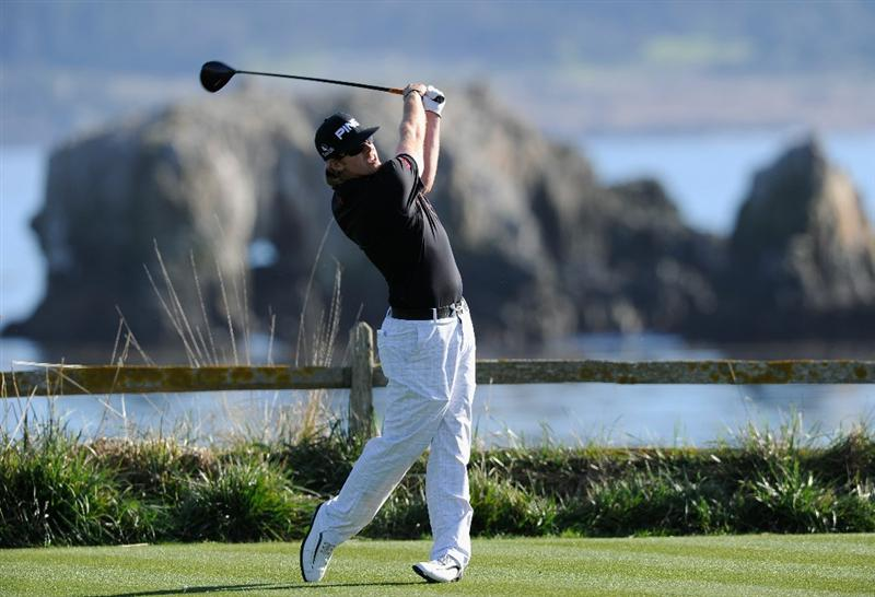 PEBBLE BEACH, CA - FEBRUARY 11:  Hunter Mahan plays his tee shot on the 18th hole during the second round of the AT&T Pebble Beach National Pro-Am at the Pebble Beach Golf Links on February 11, 2011  in Pebble Beach, California  (Photo by Stuart Franklin/Getty Images)