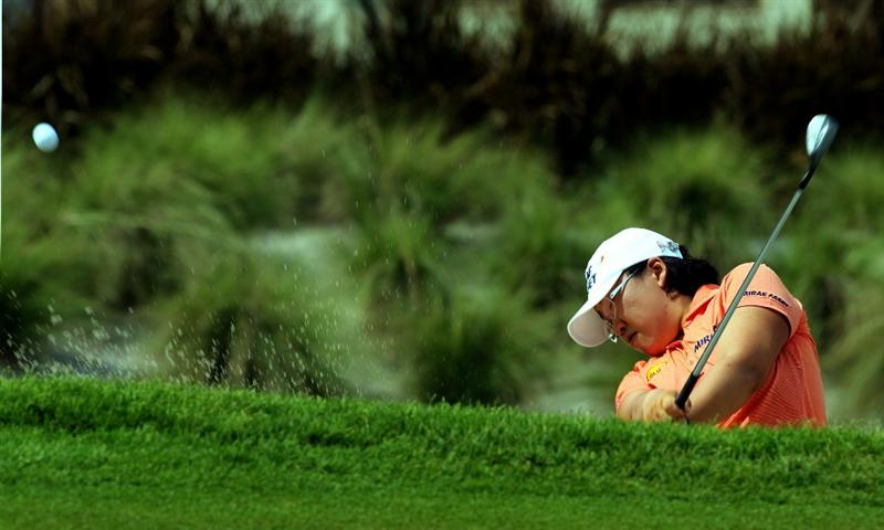 KUALA LUMPUR, MALAYSIA - OCTOBER 20 : Jiyai Shin of  Korea Republic hits out of the bunker on the 18th hole during the Official Practice on October 20, 2010 at the KLGCC Golf Course in Kuala Lumpur, Malaysia (Photo by Stanley Chou/Getty Images)