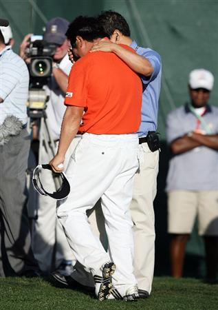 PALM BEACH GARDENS, FL - MARCH 08:  Y.E.Yang gets emotional as he celebrates with his interpreter and agent Michael Yim after winning The Honda Classic at PGA National Resort and Spa on March 8, 2009 in Palm Beach Gardens, Florida.  (Photo by Doug Benc/Getty Images)