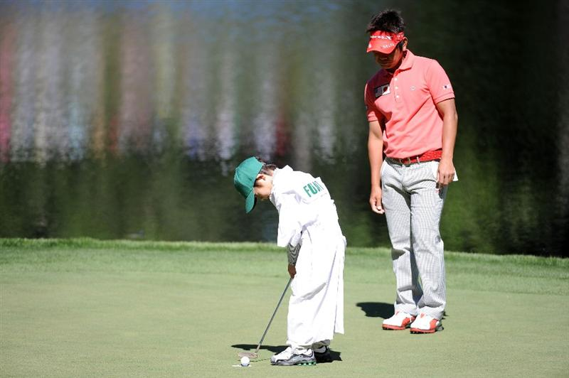 AUGUSTA, GA - APRIL 06:  Hiroyuki Fujita of Japan watches as his caddie putts during the Par 3 Contest prior to the 2011 Masters Tournament at Augusta National Golf Club on April 6, 2011 in Augusta, Georgia.  (Photo by Harry How/Getty Images)