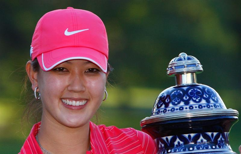 GUADALAJARA, MEXICO - NOVEMBER 15:  Michelle Wie of the United States poses with the trophy after winning the Lorena Ochoa Invitational Presented by Banamex and Corona at Guadalajara Country Club on November 15, 2009 in Guadalajara, Mexico.  (Photo by Kevin C. Cox/Getty Images)