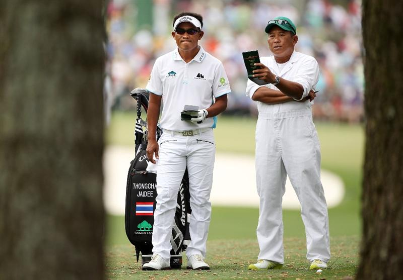 AUGUSTA, GA - APRIL 08:  Thongchai Jaidee of Thailand (L) talks with his caddie Surawut Wannapintu on the first hole during the first round of the 2010 Masters Tournament at Augusta National Golf Club on April 8, 2010 in Augusta, Georgia.  (Photo by Andrew Redington/Getty Images)